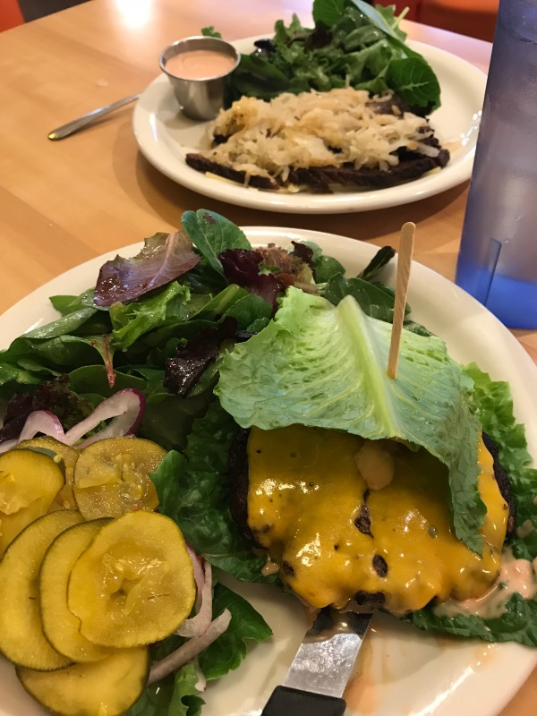 Post-keto lettuce-wrapped burger and no-bread Reuben with mixed greens salads - delicious post-keto meals at Cindy's Eagle Rock with my personal trainer in mid-July, 2018.
